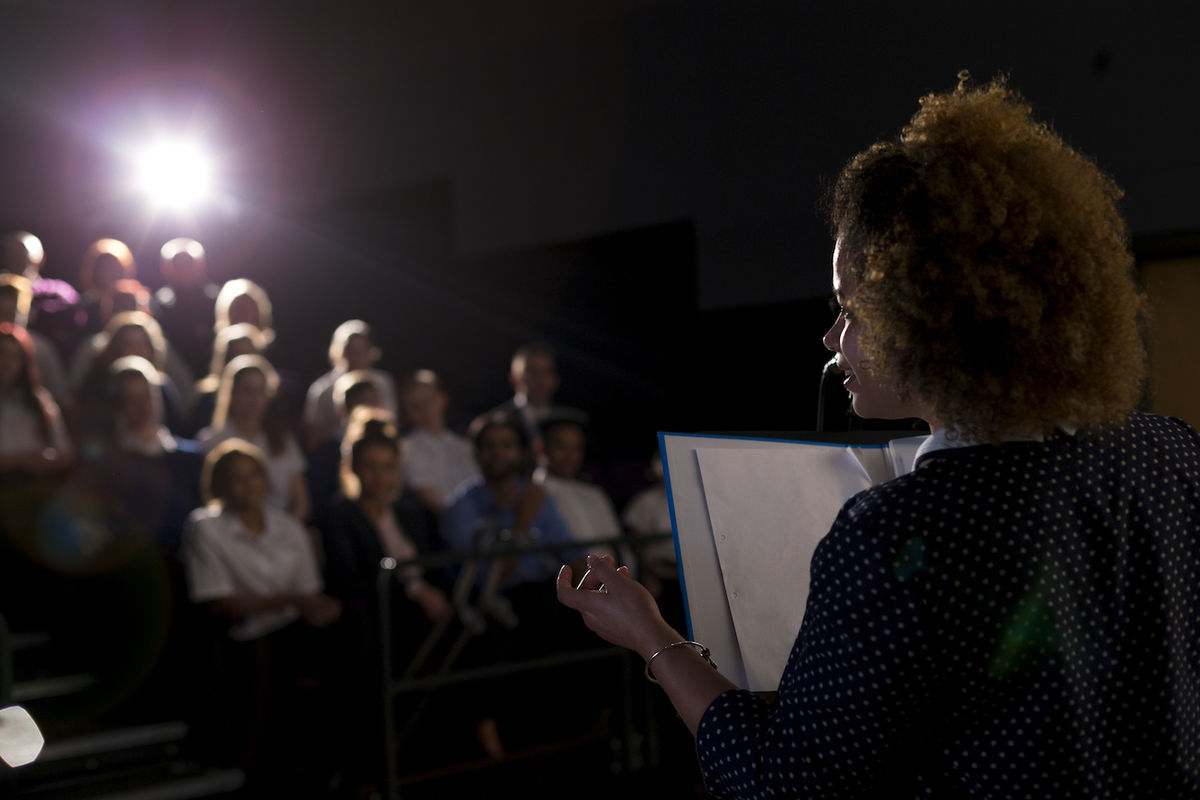 Woman Standing in front of an audience