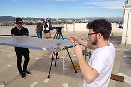 Students working on rooftop set