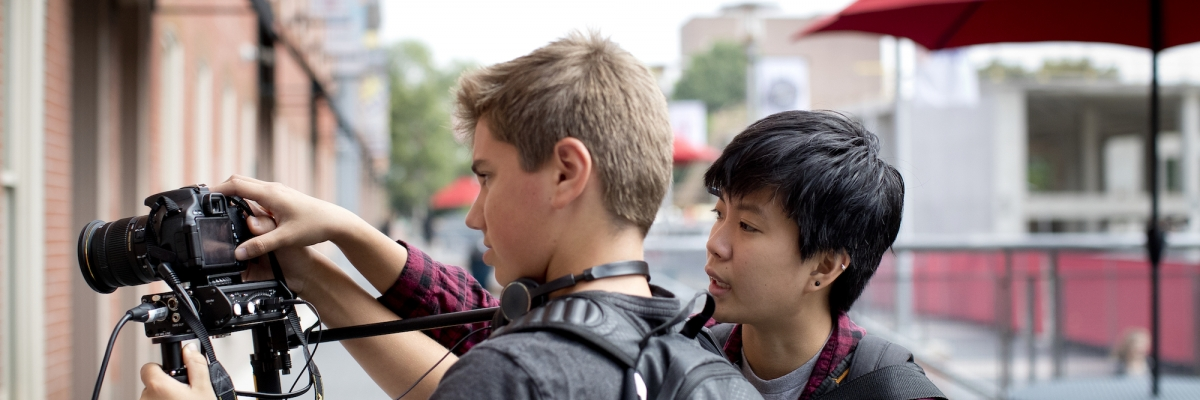 Two students with camera