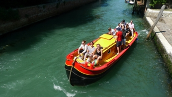 Students in a boat in Venice