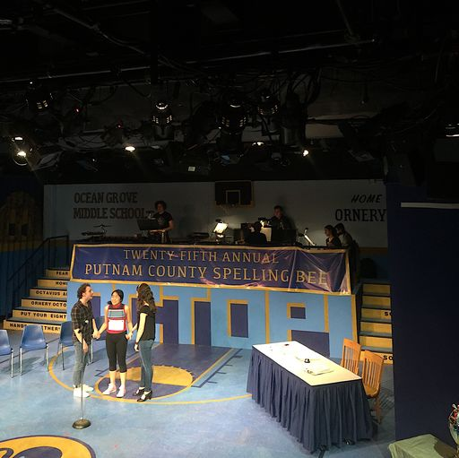 Students rehearse on set