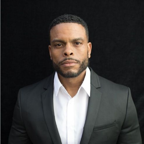 Benny Boom in gray suit