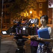 Female director at work, at night